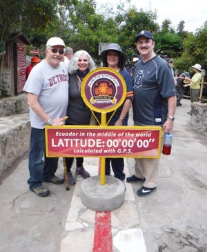 Bob and Linda Bodzin of Farmington Hills, left, and Diane and Guy Trupiano of Livonia took the D to the equator in May when they visited the Intinan Solar Museum in Quito, Ecuador. A line running through the museum is said to mark the boundary between  Earth's Northern and Southern hemispheres. The Bodzins and Trupianos were in Quito prior to embarking on a trip to the  Galapagos Islands.