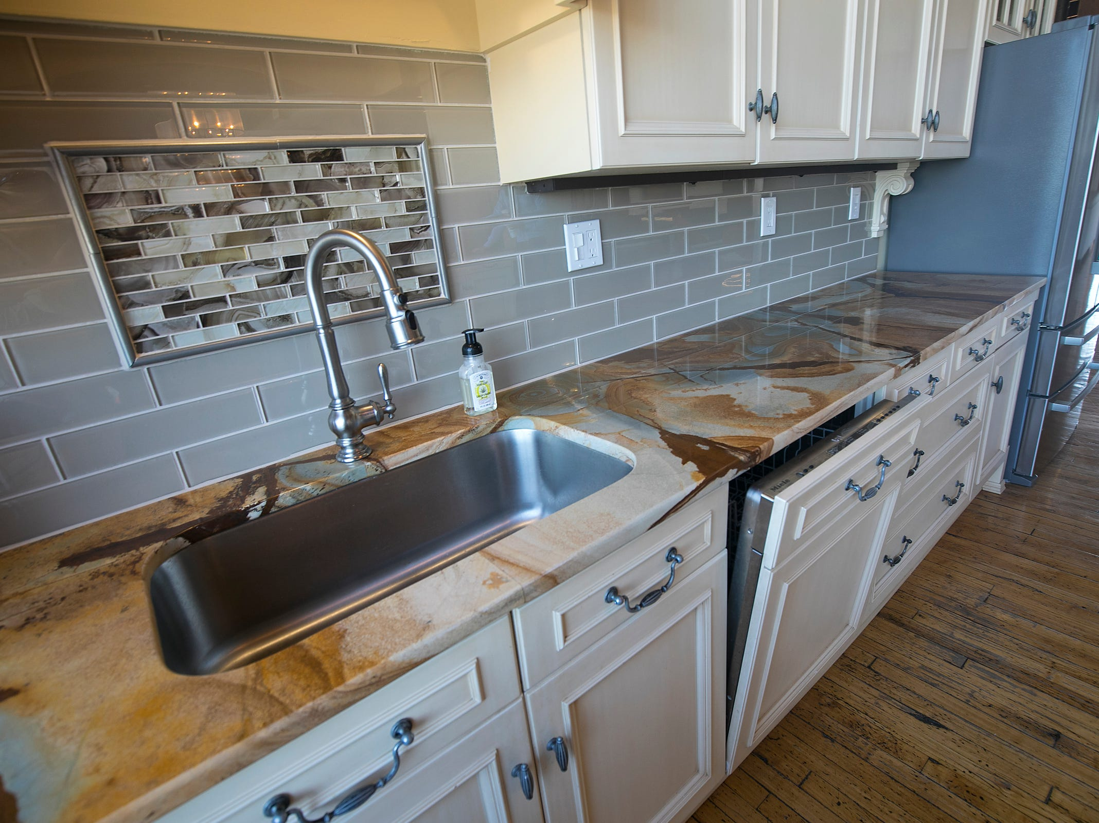 There is a very large kitchen--many cabinets, an island, double oven, two sinks, granite, Wolf and Bosch appliances.