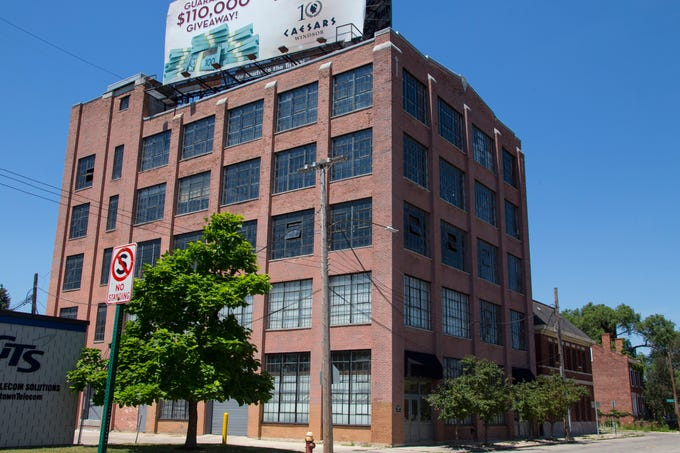 The loft is the entire fourth floor of the 1920 Westinghouse factory on the east side of Corktown in Detroit. Its elevator is big, old and industrial.