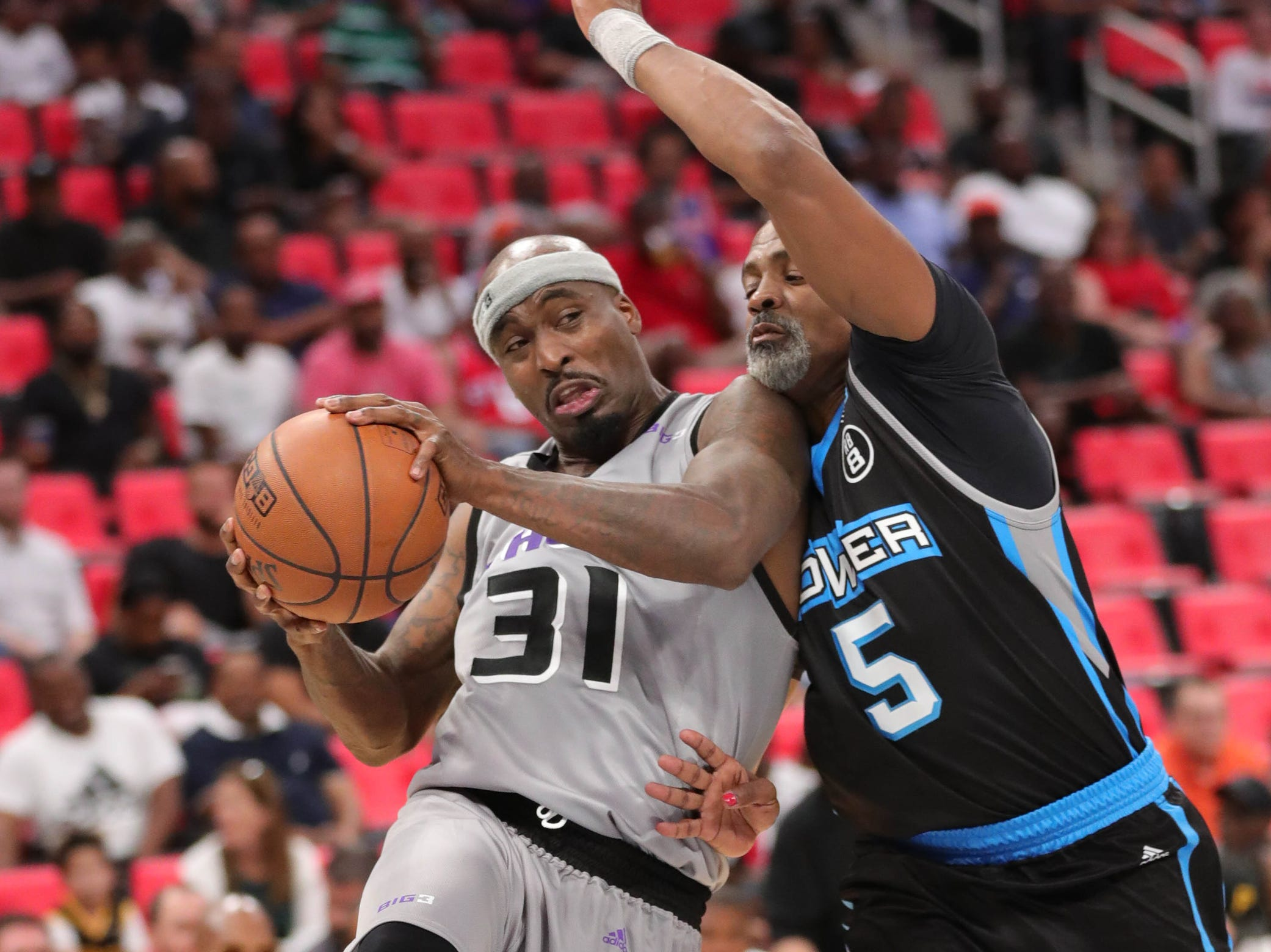 Ghost's Ricky Davis drives against Power's Cuttino Mobley during BIG3 action on Friday, July 13, 2018 at Little Caesars Arena in Detroit.
