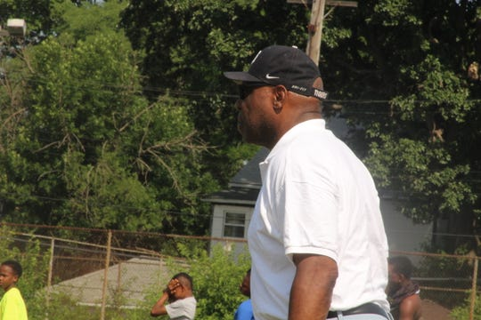 Reggie McKenzie watches during his football camp on Tuesday, July 10, 2018, in Highland Park.