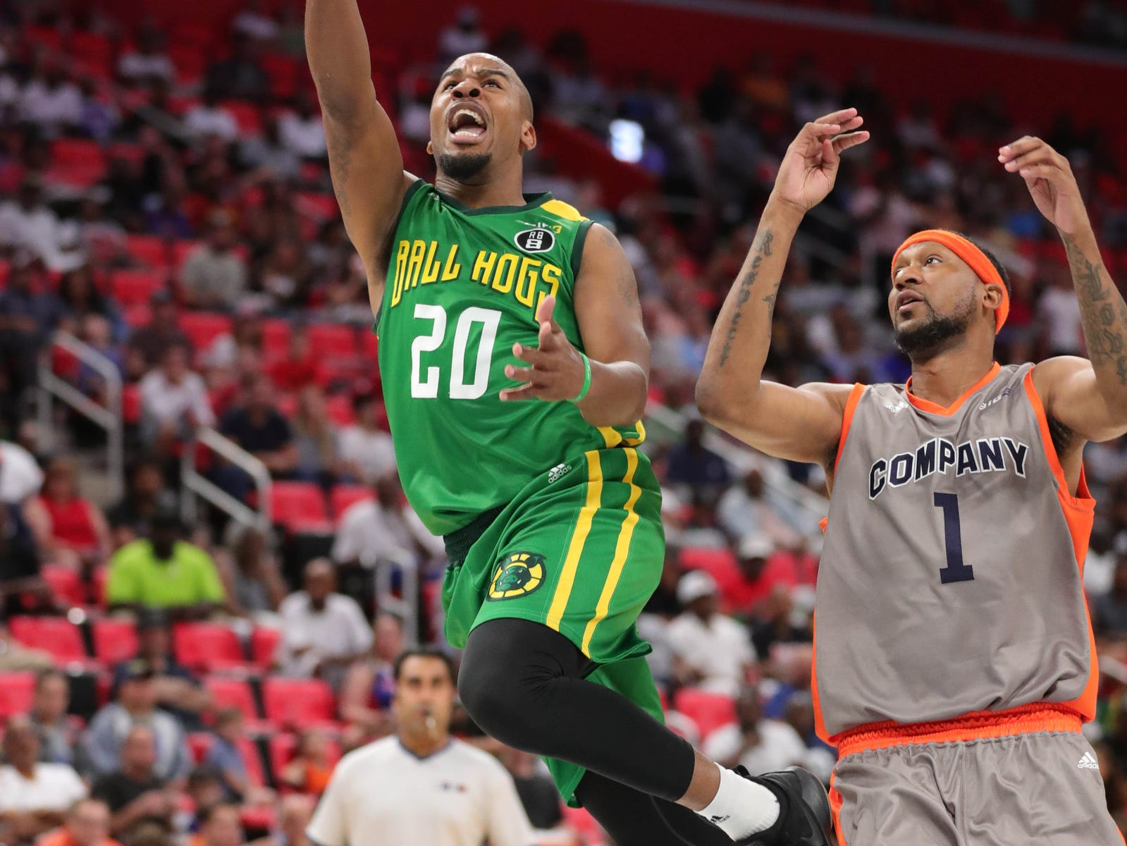 Ball Hogs Andre owens scores against 3s Company's DeMarr Johnson during BIG3 action on Friday, July 13, 2018 at Little Caesars Arena in Detroit.