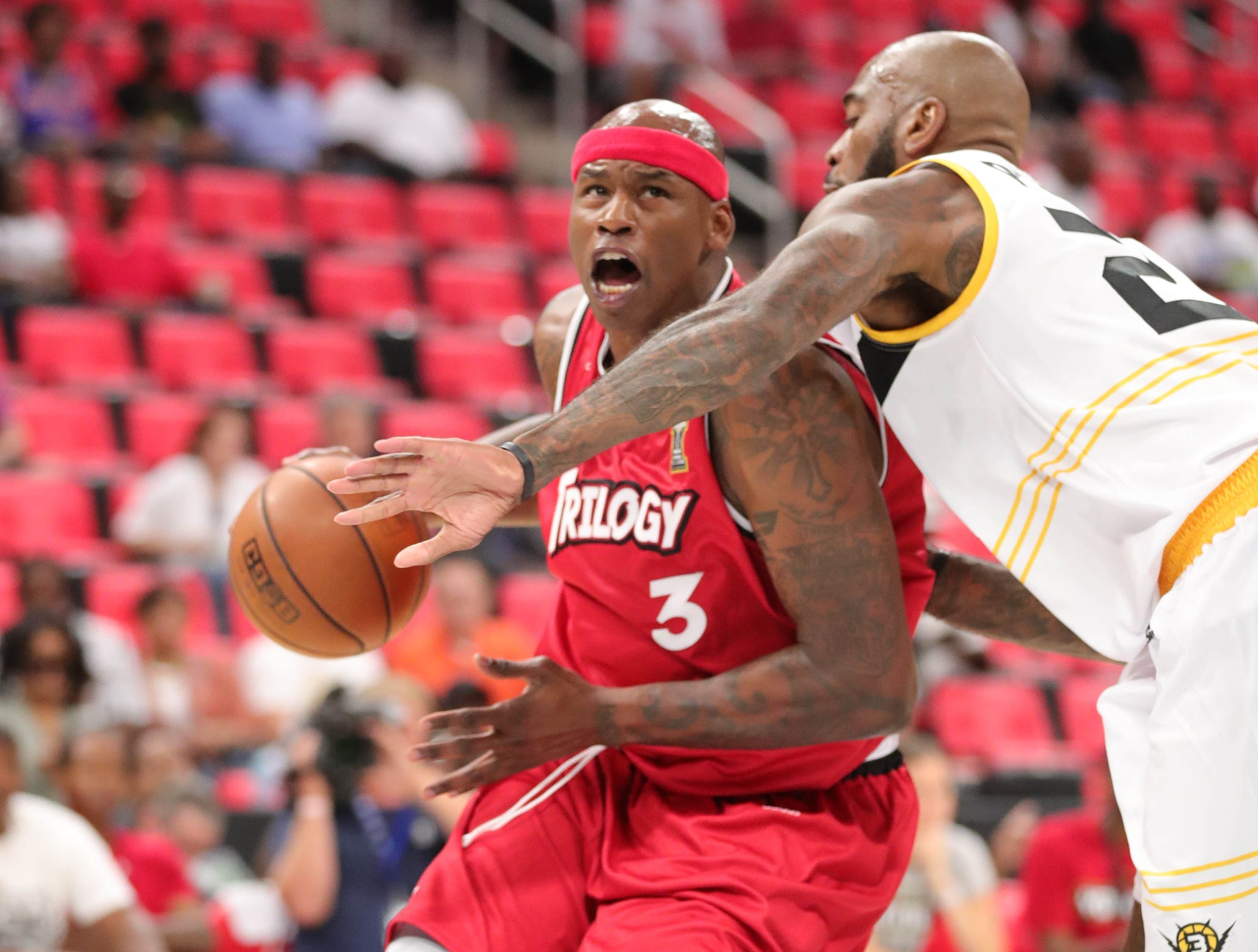 Trilogy's Al Harrington drives against Killer 3s Josh Powell during BIG3 action on Friday, July 13, 2018 at Little Caesars Arena in Detroit.
