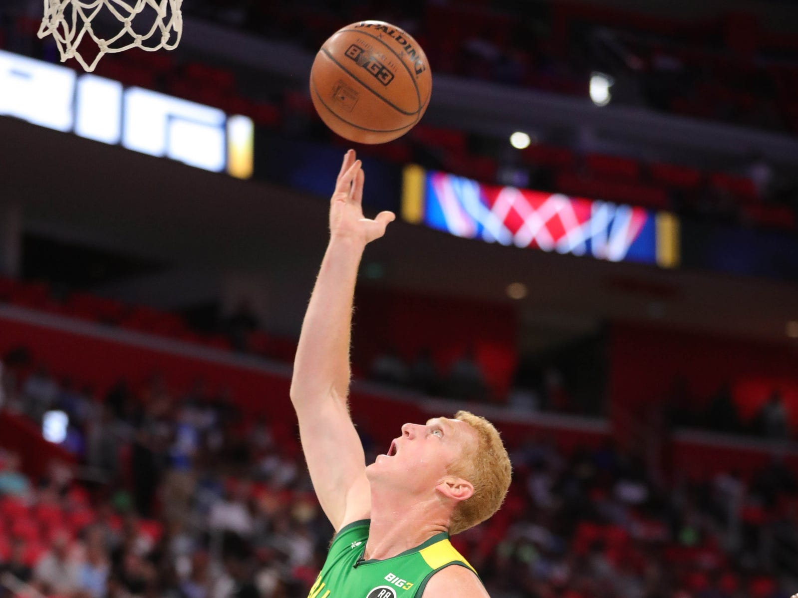 Ball Hogs Brian Scalabrine drives against 3s Company's Dahnytay Jones during BIG3 action on Friday, July 13, 2018 at Little Caesars Arena in Detroit.