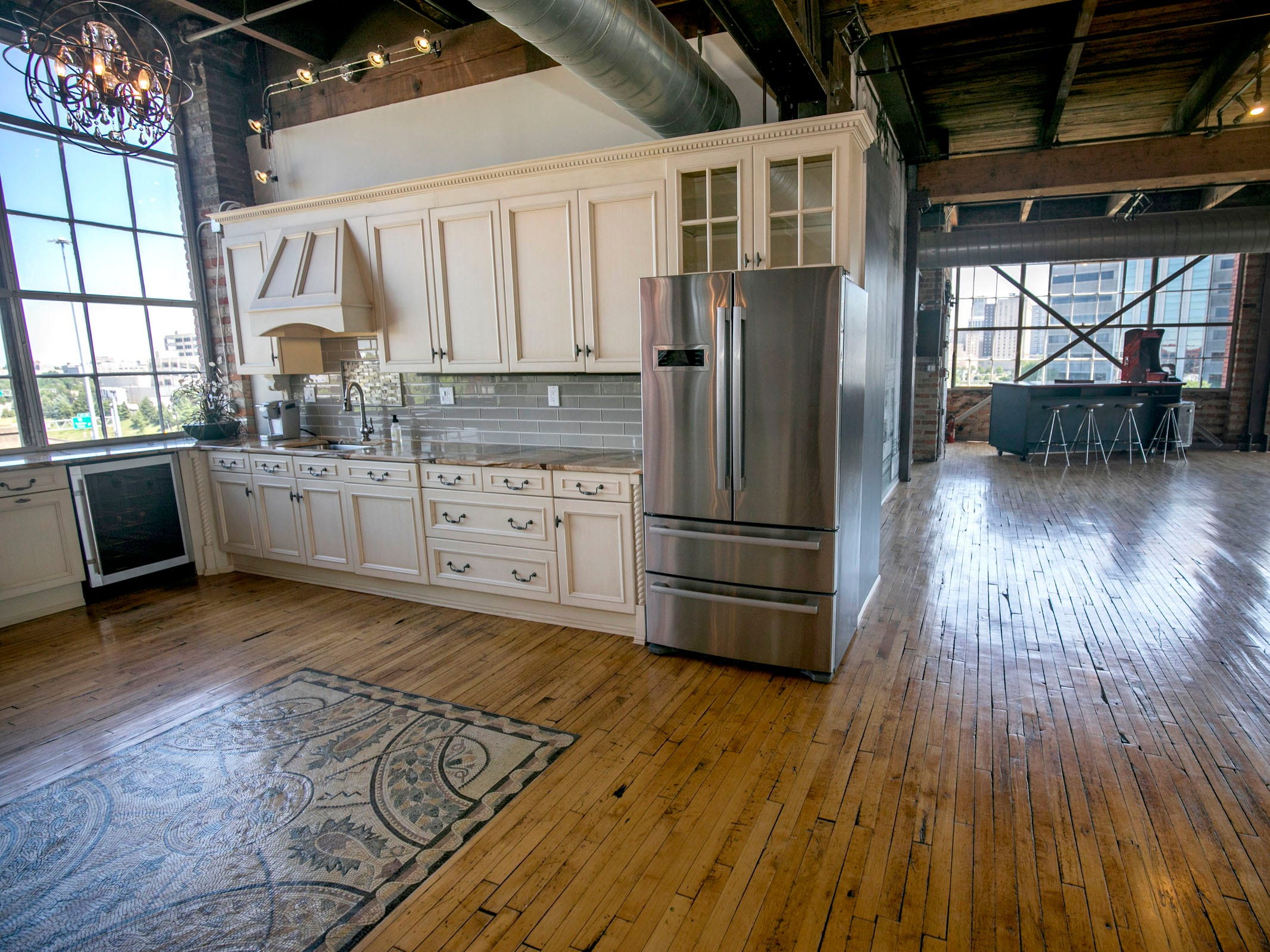 The large kitchen is new, with appliances by Wolf and Bosch. The floor design is mosaic with 41,000 pieces, commissioned by the previous owner.