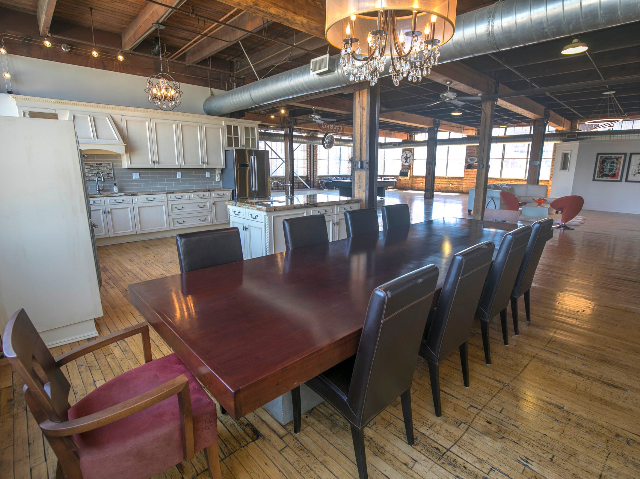 The kitchen and dining area face Michigan Avenue. The owners replaced overhead lighting with fixtures that are industrial, contemporary or retro.