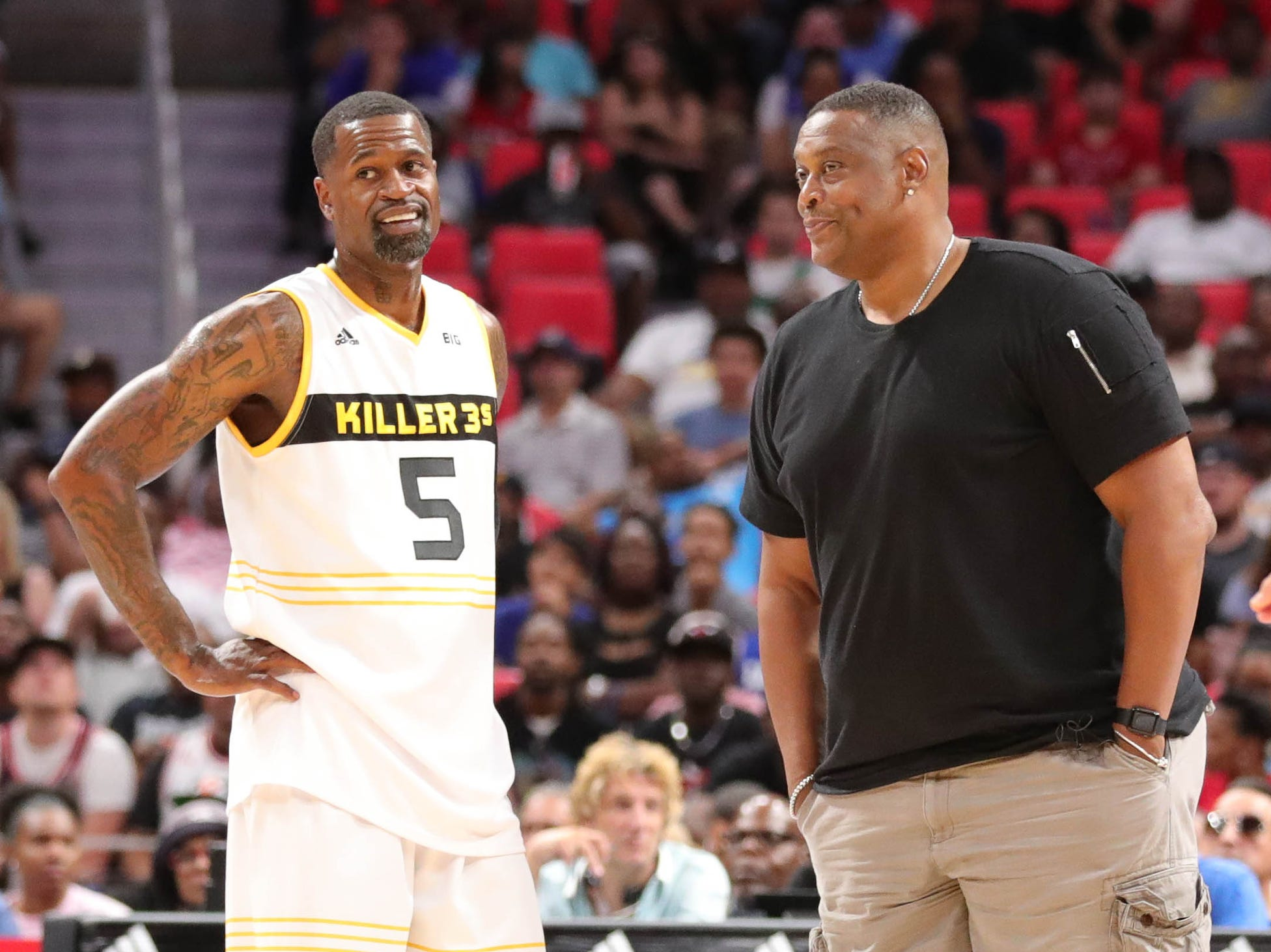 Trilogy head coach Rick Mahorn talks with Killer 3s player Stephen Jackson during BIG3 action on Friday, July 13, 2018 at Little Caesars Arena in Detroit.