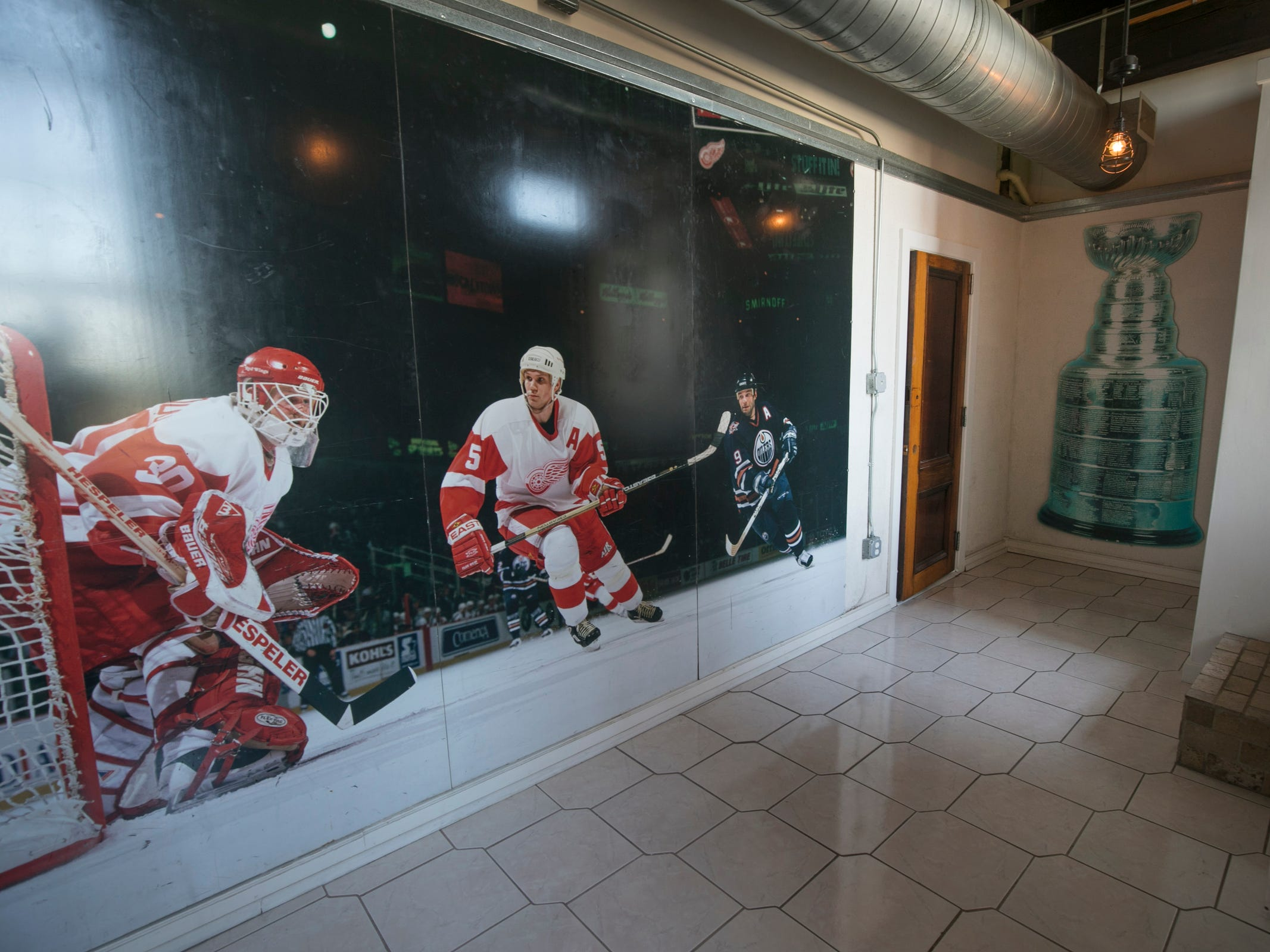 The Red Wings-in-action wall covering came from this spring's auction at Joe Louis Arena. The loft renovation was done by a suburban family that likes to stay in the city for Red Wings, Tigers and other events.