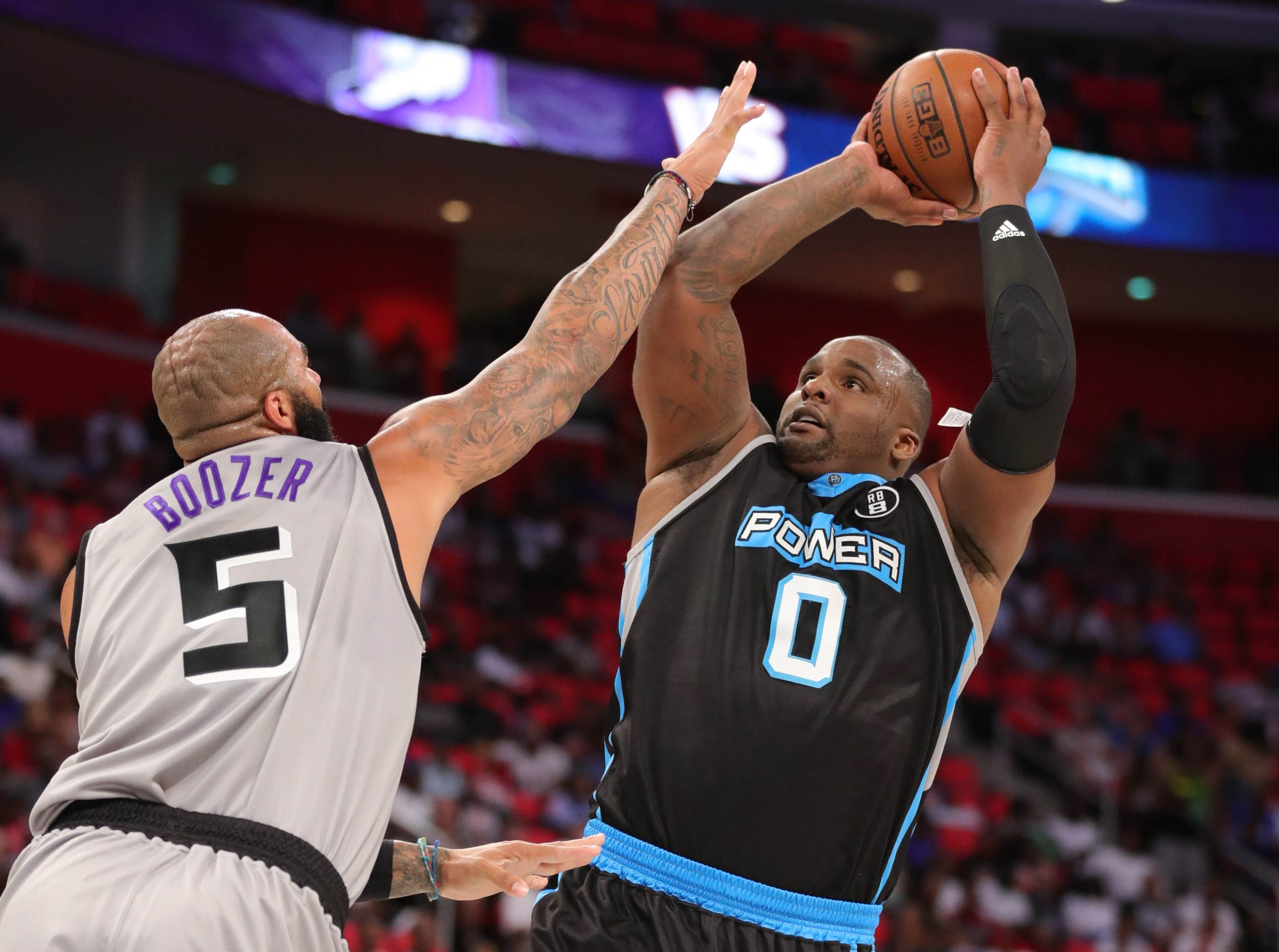 Ghost's Carlos Boozer defends against Power's Glen Davis during BIG3 action on Friday, July 13, 2018 at Little Caesars Arena in Detroit.