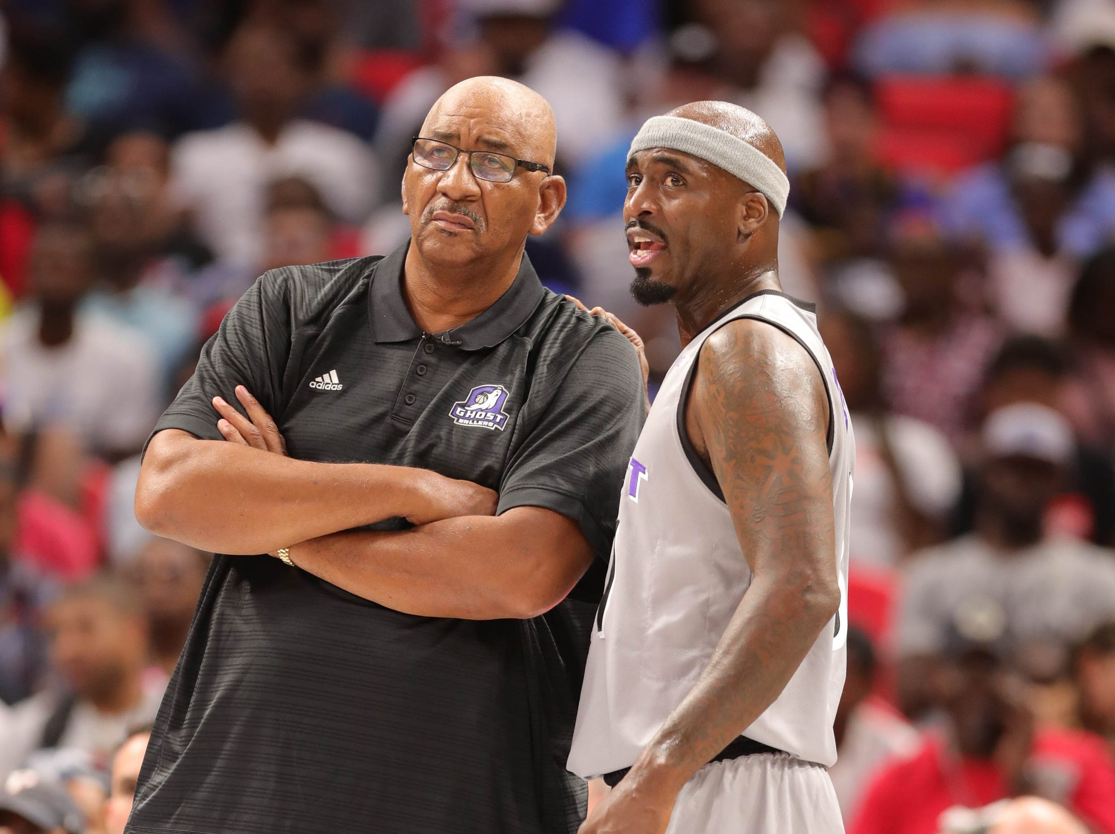 Ghost's  head coach George Gervin and Ricky Davis on the bench during BIG3 action on Friday, July 13, 2018 at Little Caesars Arena in Detroit.