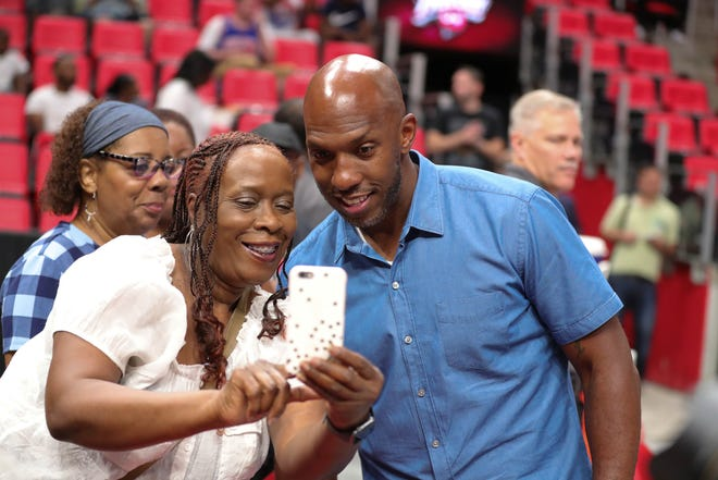Chauncey Billups takes a picture with Patricia Baker during BIG3 action on Friday, July 13, 2018 at Little Caesars Arena in Detroit.