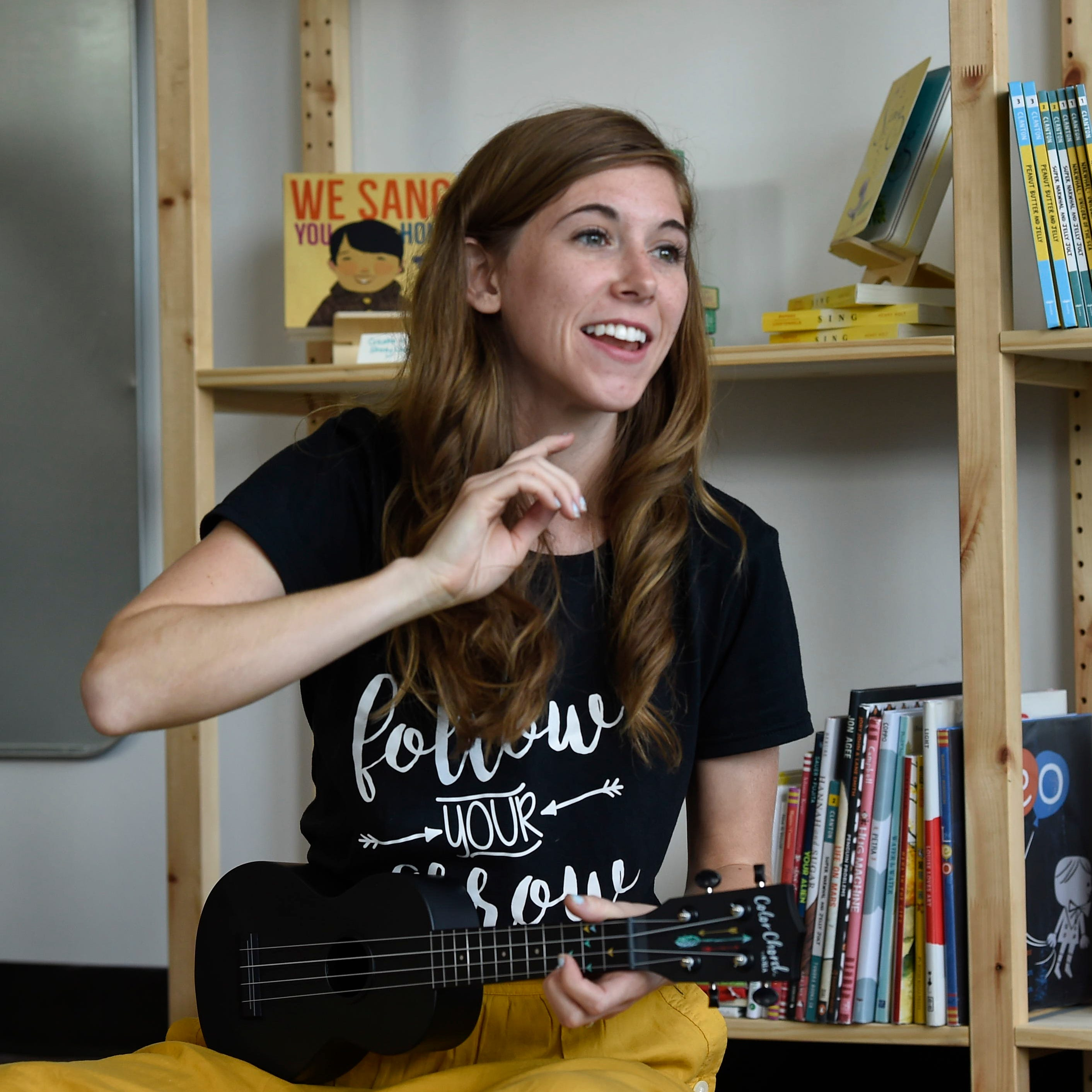 Emily Arrow, YouTube picture book songwriting sensation, shows teachers how to ukulele
