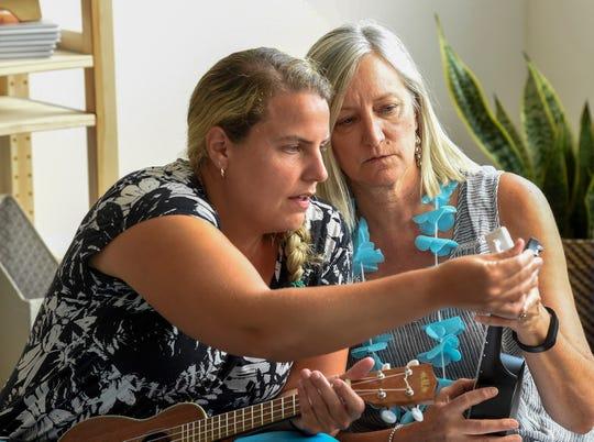 Jill Nowacek helps Kathy Suydam tune her ukulele during the second annual Teacher Summit in Nashville, Tenn., Saturday, July 14, 2018.