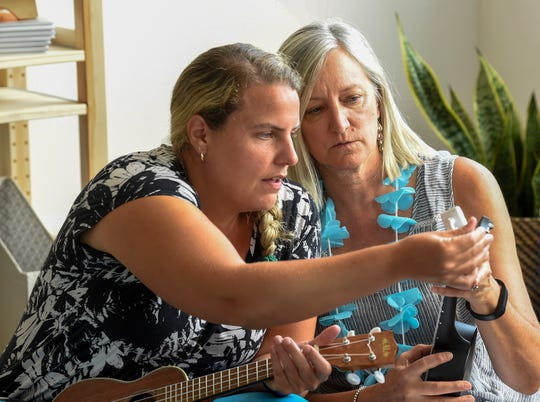 Jill Nowacek helps Kathy Suydam tune her ukulele during the second annual Teacher Summit in Nashville, Tenn., Saturday, July 14, 2018.