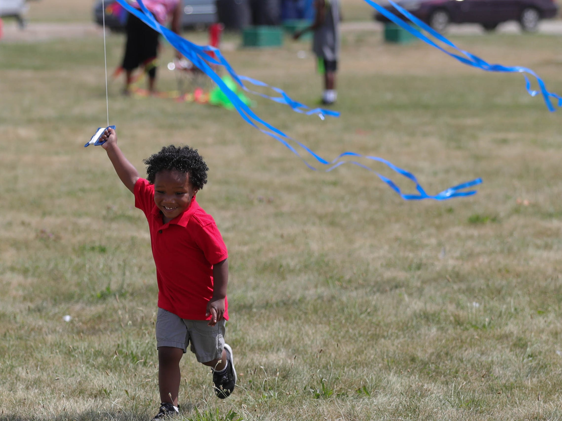 Cameron Harris tries to get his kite airborne during the Detroit Kite Festival on Belle Isle Sunday, July 15, 2018.