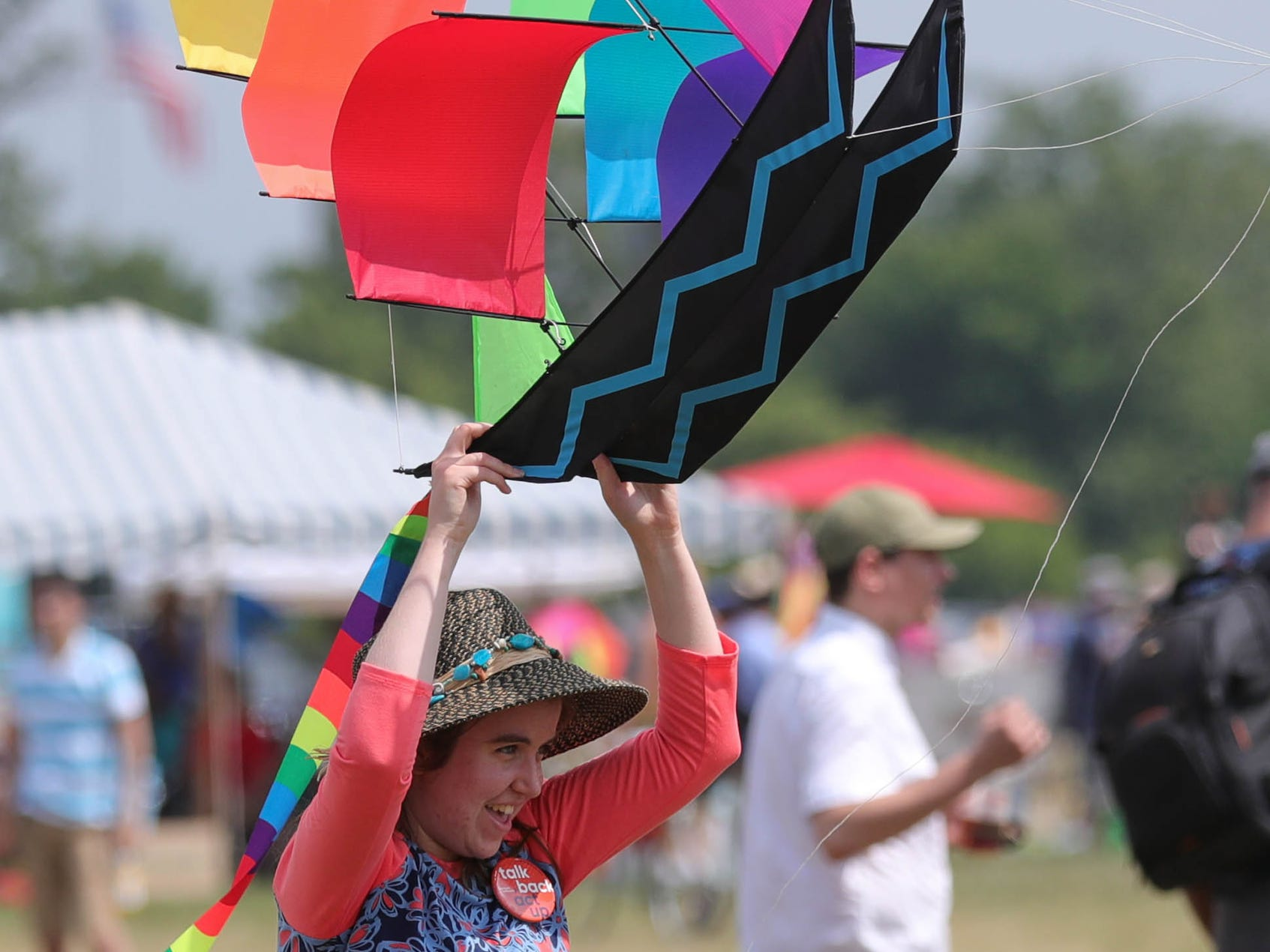 Katie Crombez tries to get her kite airborne during the Detroit Kite Festival on Belle Isle Sunday, July 15, 2018.