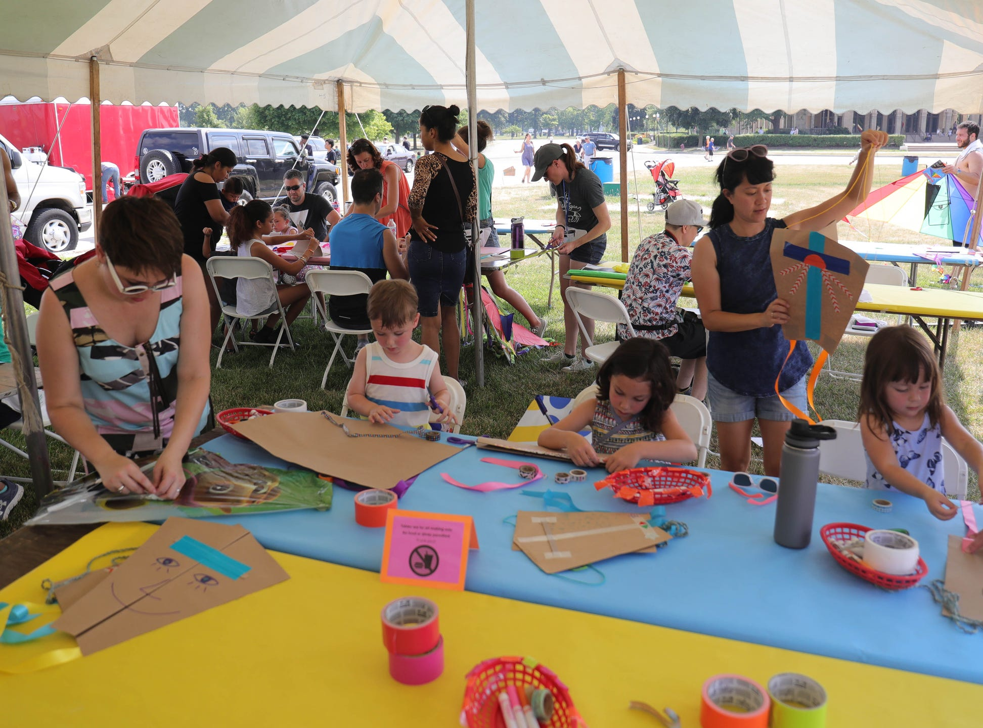 Kite enthusiasts design and assemble kites during Detroit Kite Festival on Belle Isle Sunday, July 15, 2018.