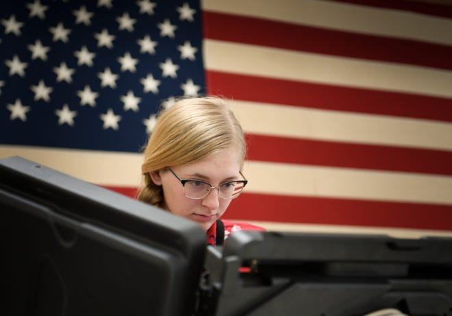 Meghan Gragg casts her ballot during early voting July 16, 2018, at the Williamson County Election Commission in Franklin.