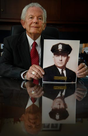 Davidson County Trustee Charlie Cardwell with a photo of his father Charles Cardwell Sr. Monday, July 16, 2018, in Nashville, Tenn. .