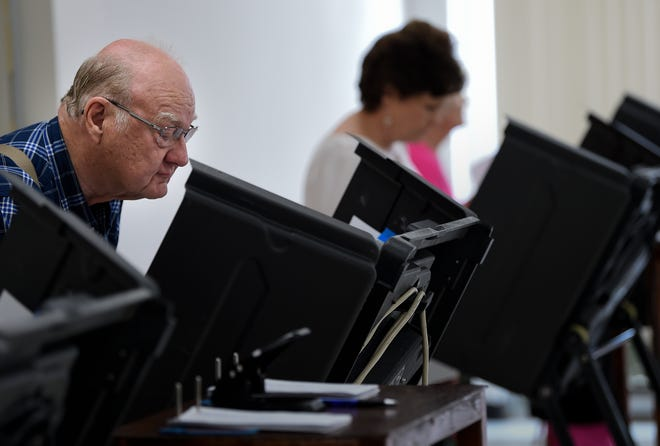 Raymond Spears casts his ballot during early voting at the Williamson County election commission Monday, July 16, 2018, in Franklin, Tenn.