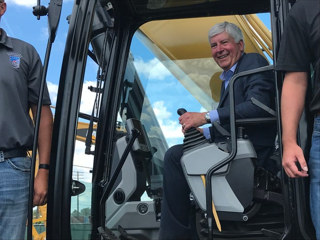 Gov. Rick Snyder poses for a photo during the Gordie Howe International Bridge Project ceremonies Tuesday, July 17, 201,8 in the Del Ray neighborhood of Detroit.