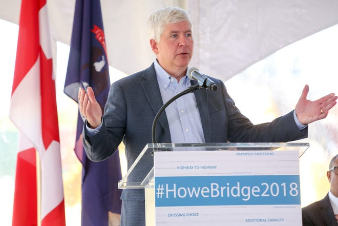 Michigan Governor Rick Snyder speaks during the groundbreaking ceremony for the Gordie Howe International Bridge in the Delray neighborhood of Detroit on Tuesday, July 17, 2018.