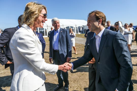U.S. Ambassador to Canada Kelly Craft, shakes hands with Lt. Gov. Brian Calley at the groundbreaking for the start of the Michigan advance construction for the Gordie Howe International bridge project in the Delray neighborhood of Detroit on July 17, 2018.
