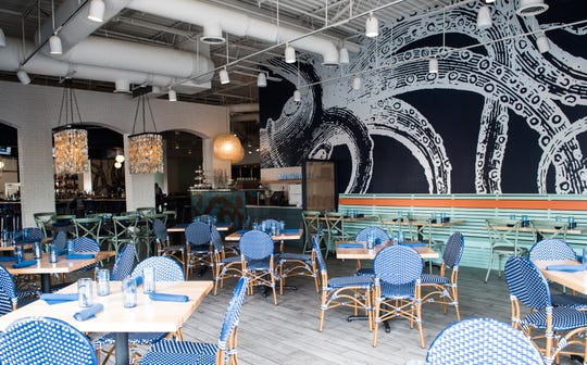 The dining room features an undersea mural and oyster shell chandeliers.