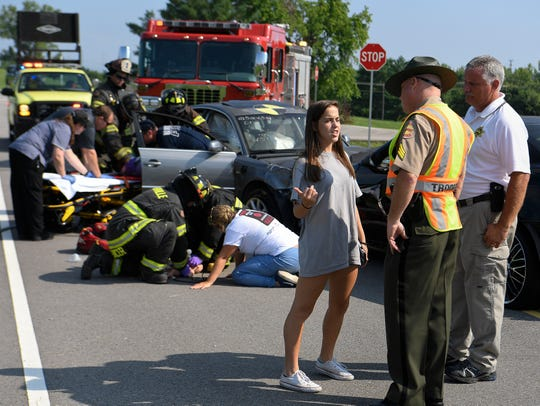 Kristin Undzis explains how she was distracted by an electronic device to a State Trooper during a mock crash scene during a Teen Driver Education Camp held by the Tennessee Department of Safety and Homeland Security Tuesday, July 17, 2018, in Nashville, Tenn.