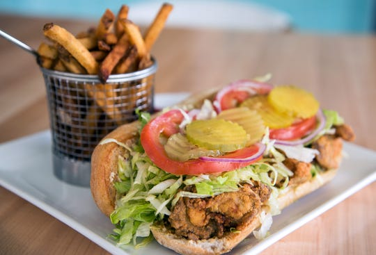 Fried shrimp po' boy with house fries