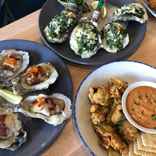 Trio of oysters, clockwise from left:roasted crawfish and bacon topped LaFitte, roasted Rockefeller, deep-fried Mississippi with comeback sauce and saltines.