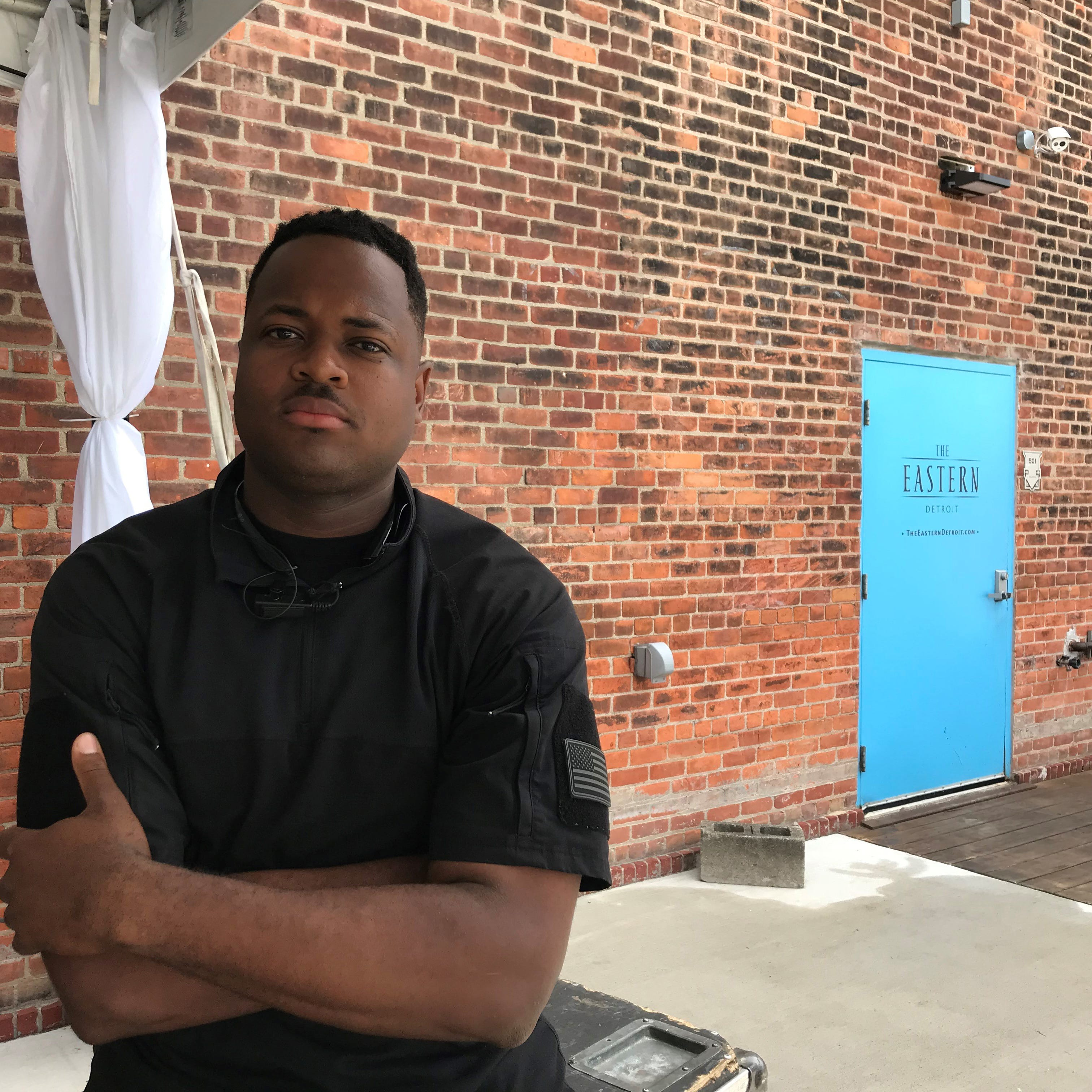 Ibrahim Mission sits outside The Eastern, an Eastern Market event space where a prominent white business-owner spat in his face Tuesday, July 17, 2018.