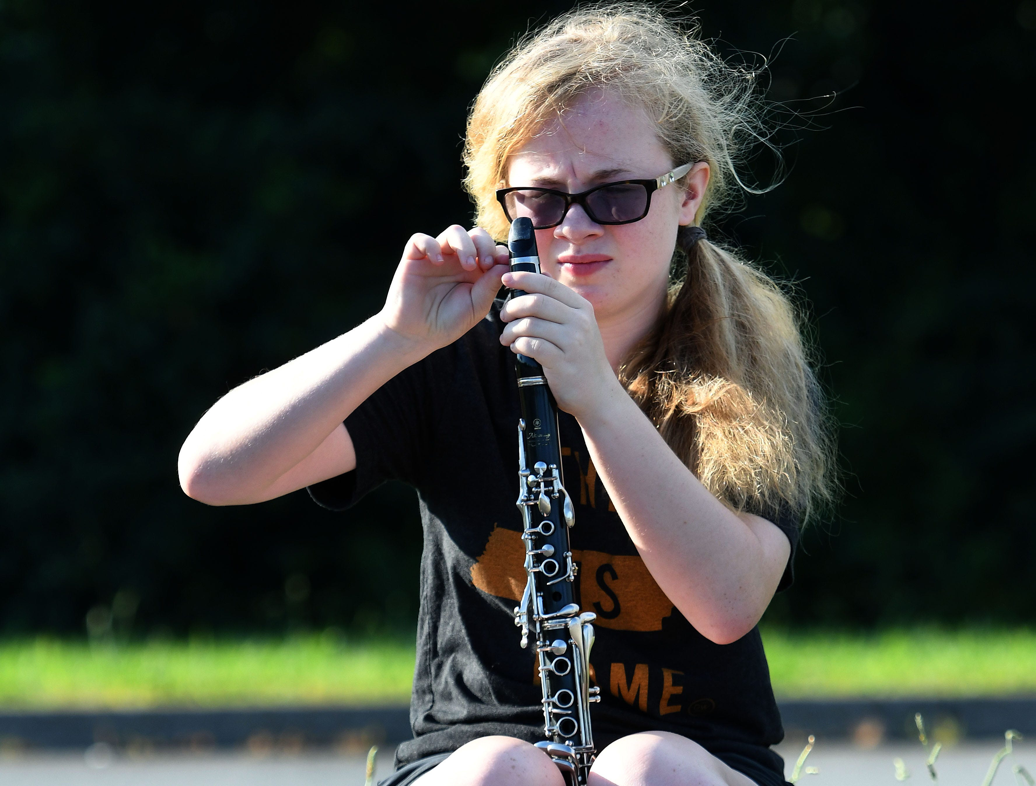 Abbey Howard gets her clarinet ready for Farragut High School band camp Wednesday, July 18, 2018 on a parking lot at the high school.