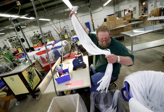 In this May 17, 2018, photo, Barry Brown works at the Dunlap Industries facility in Dunlap, Tenn. The small zipper-making company is fighting to keep its pared-down staff occupied after it lost federal contracts to provide zippers for military uniforms. (AP Photo/Mark Humphrey)