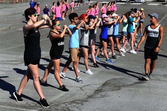 Sectional drills during Farragut High School band camp Wednesday, July 18, 2018 on a parking lot at the high school.