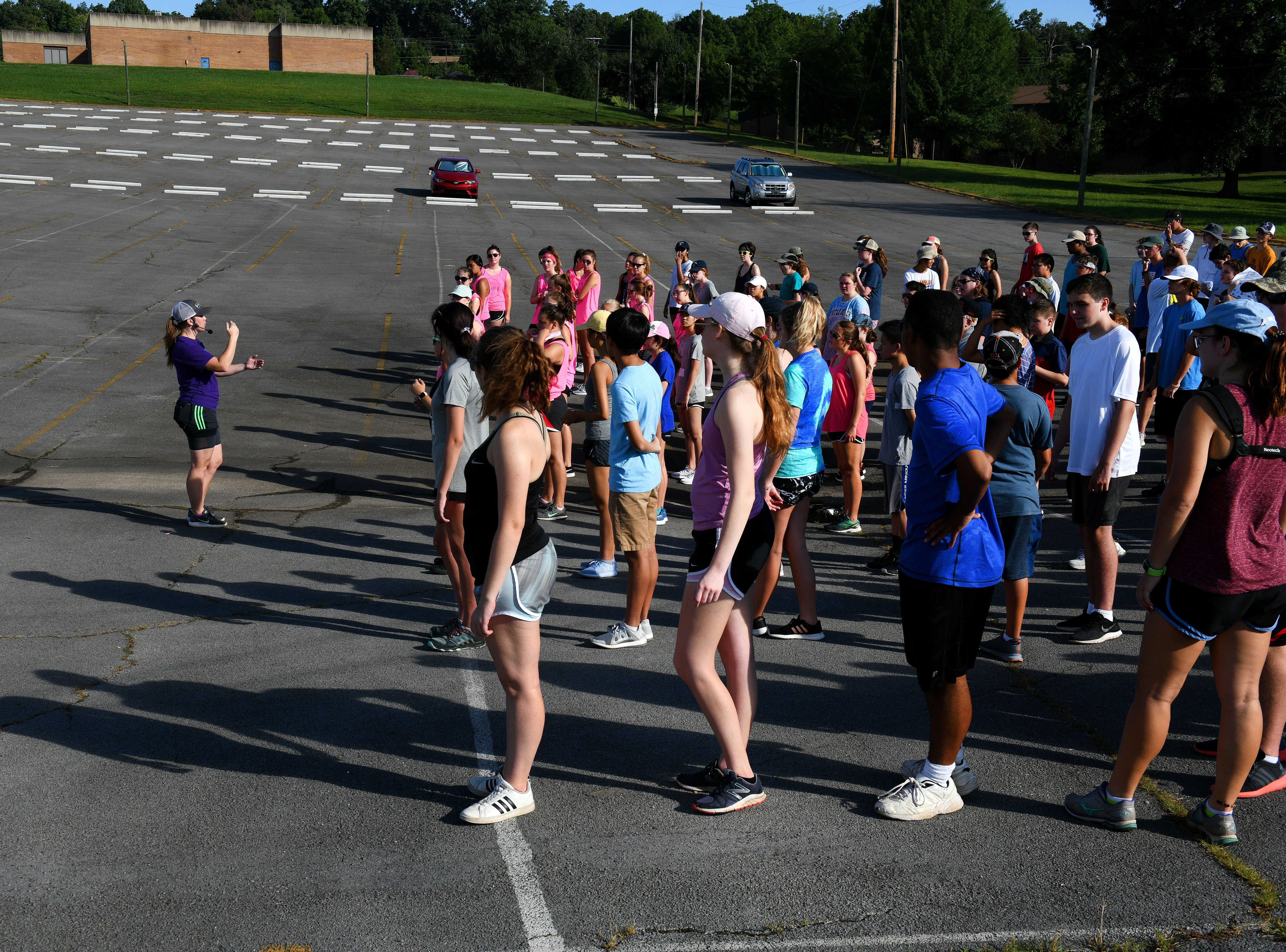 Assistant director Elizabeth Gott leading drills during Farragut High School band camp Wednesday, July 18, 2018 on a parking lot at the high school.