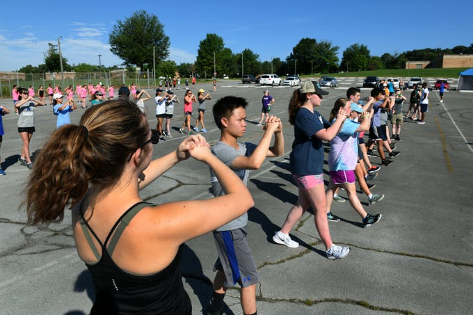 Drills during Farragut High School band camp Wednesday, July 18, 2018 on a parking lot at the high school.