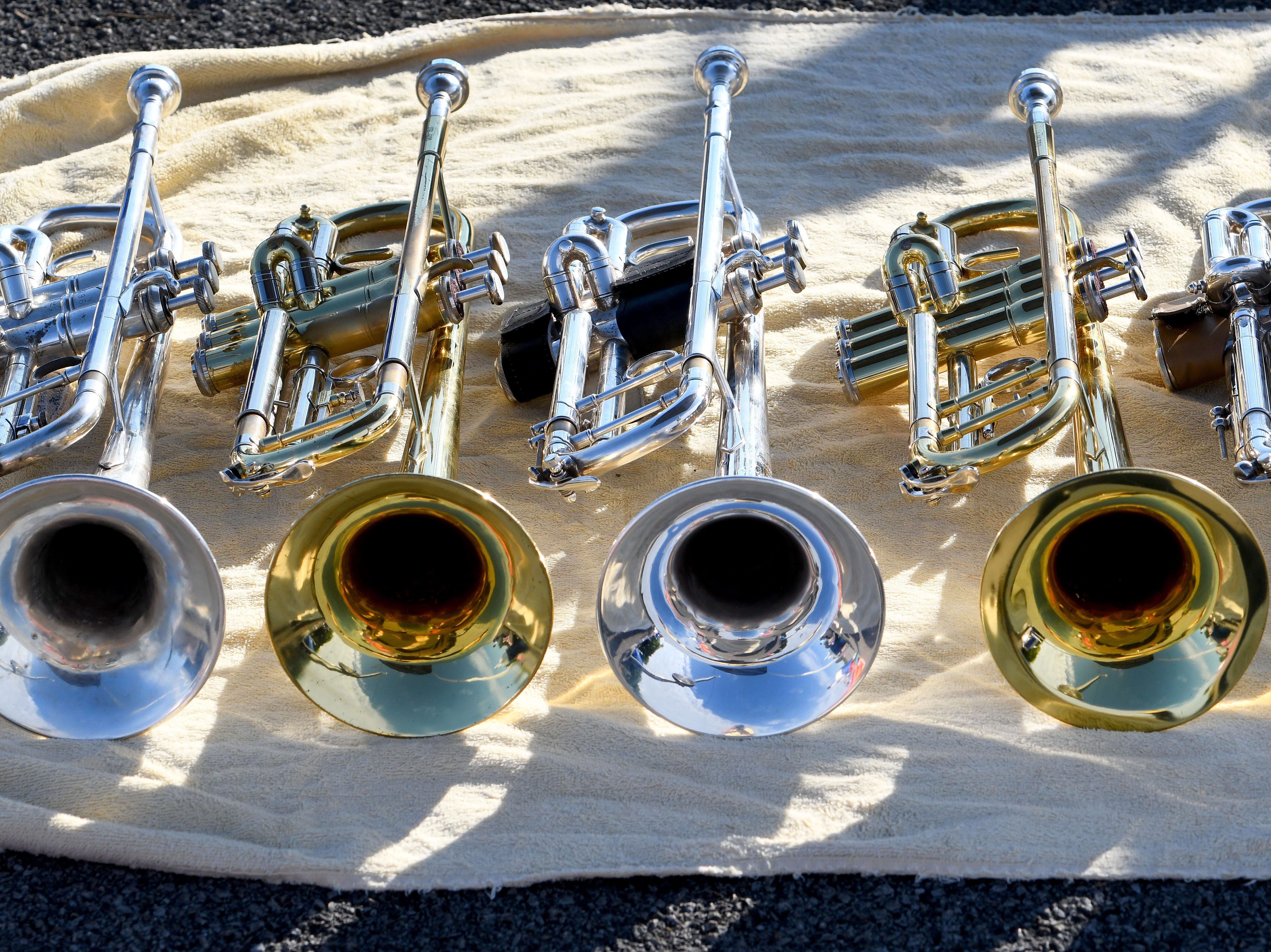 Instruments ready for second half of day at Farragut High School band camp Wednesday, July 18, 2018 on a parking lot at the high school.