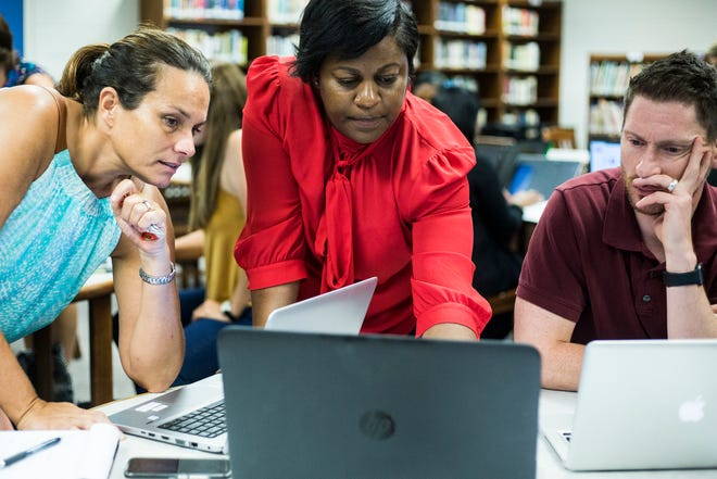July 18, 2018 - Comaneci Brooken, center, a client success partner with BrightBytes, helps Renae Bingham, left, and Troy Stagner during a training session for a new data system being deployed throughout Shelby County Schools. The new system is being deployed throughout Shelby County Schools this fall.