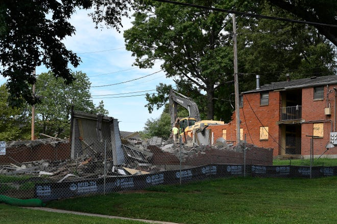 Construction workers demolish old public housing at the James Cayce Homes on a site proposed for a new charter school to be run by the Martha O'Bryan Center  Wednesday, July 18, 2018, in Nashville, Tenn. .