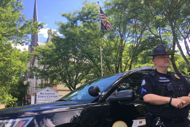 Richmond police Cpl. Rick Greenough stands outside of Richmond Town Center, which also houses the police department, on Wednesday, July 18, 2018.