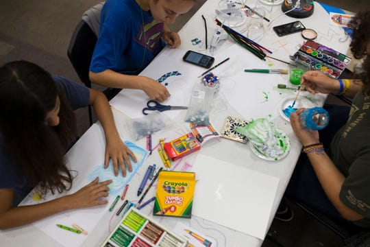 Kids work on projects during the Bad Art Afternoon on Thursday, July 19, 2018 at La Retama Central Library.