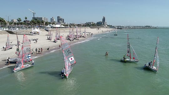 Boaters launch from McGee Beach on day four of the Youth Sailing Worlds on Thursday, July 19, 2018.