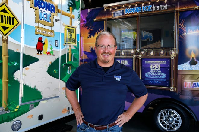 Tony Lamb, CEO of Kona Ice with their Kona truck left and the new krafted truck, right, at their headquarters in Florence. The new krafted truck is geared toward adults. Flavors include, Irish coffee, bourbon black cherry vanill and peach ghost pepper. Photo shot Thursday July 19,2018.