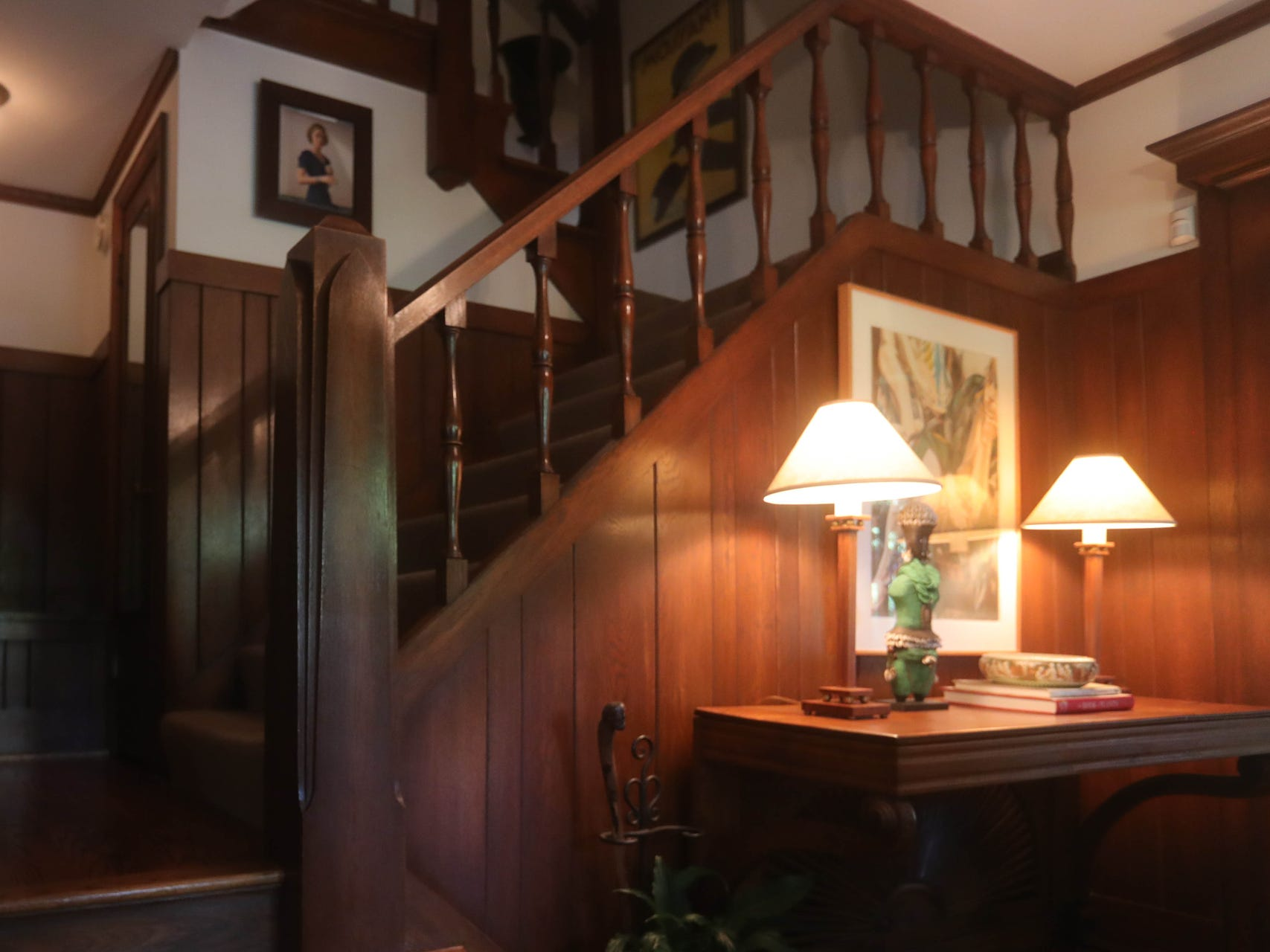 The entry foyer and staircase are paneled with oak.