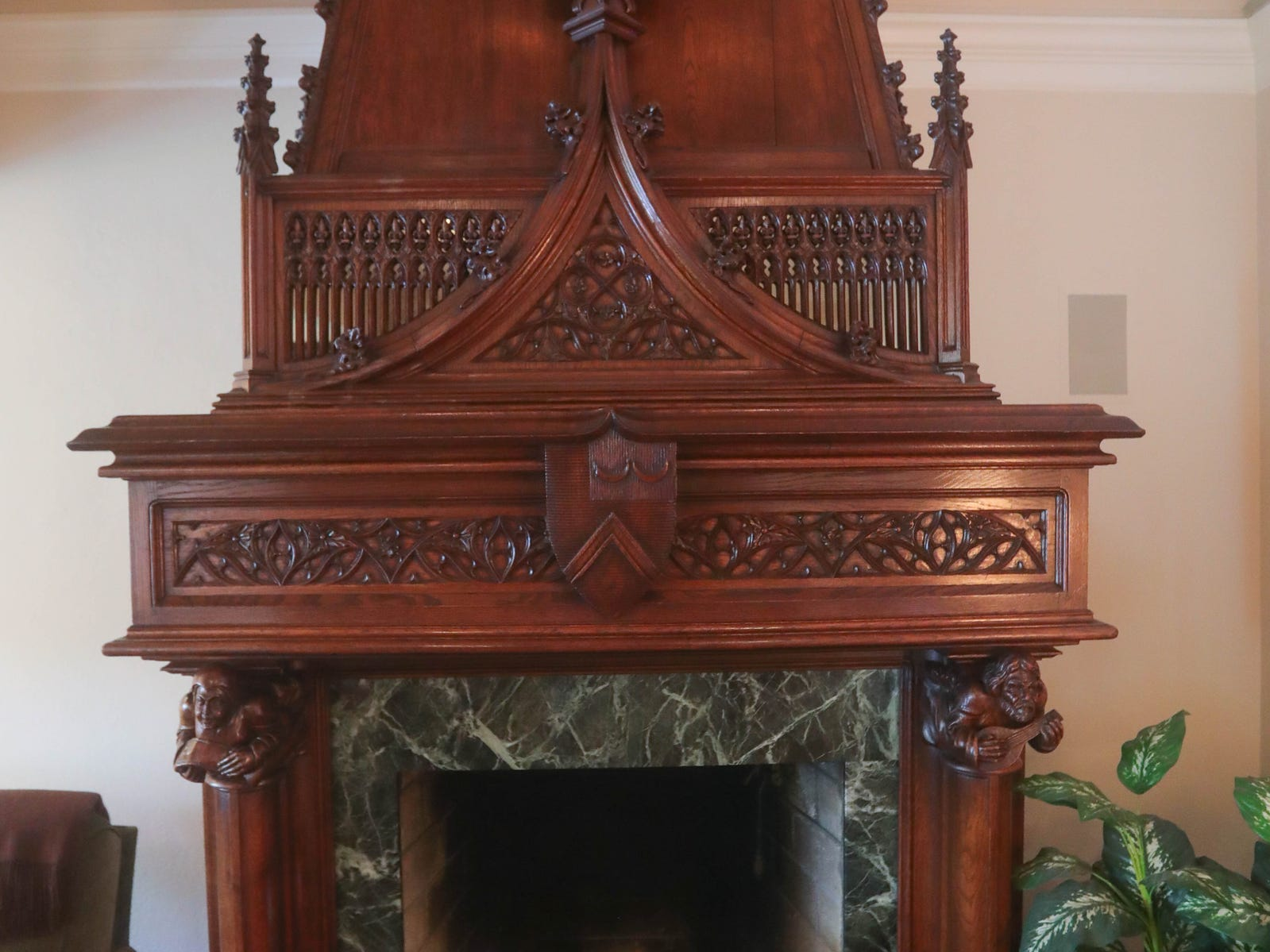 The elaborate carved oak fireplace is said to be 400 years old. It was bought in France, then taken apart and shipped here to be reassembled.
