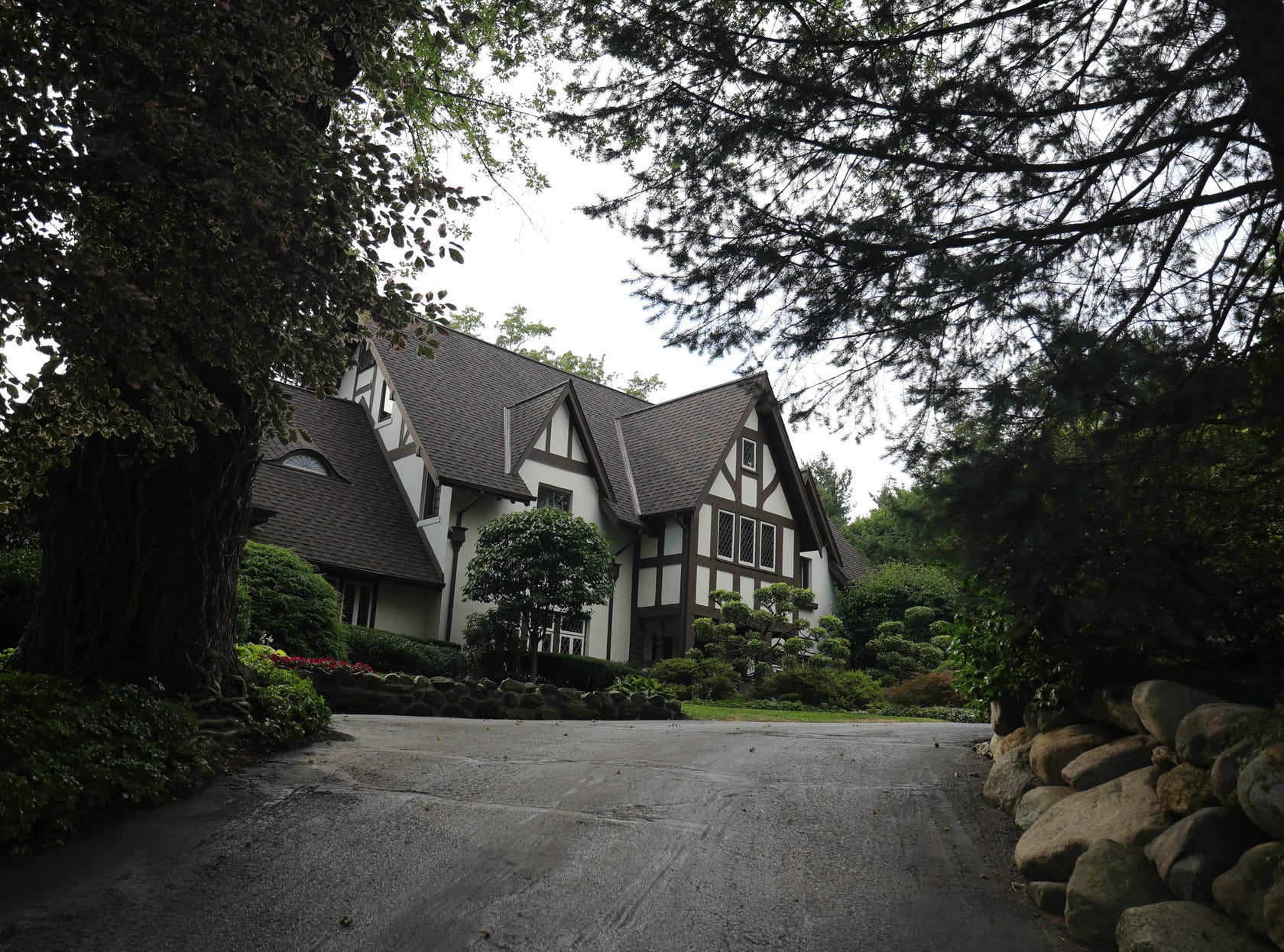 The 1908 Tudor estate was built on 23 acres and filled with luxuries like stained and leaded glass. It's the founding mansion of the upscale subdivision built around it later.