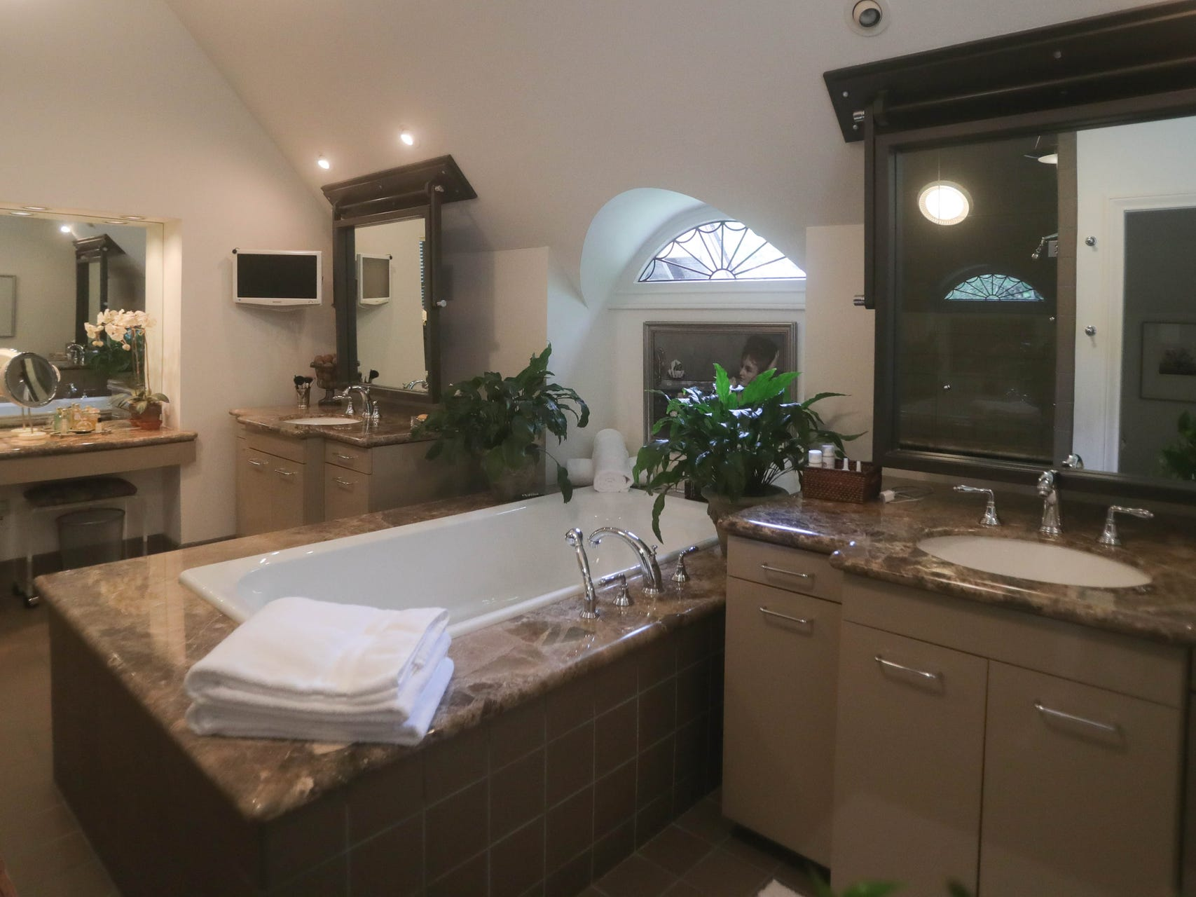 The owners' suite includes a large new walk-in closest and a glamorous bath.
