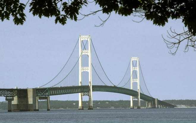 In this July 19, 2002, file photo, the Mackinac Bridge that spans the Straits of Mackinac is shown from Mackinaw City, Mich.