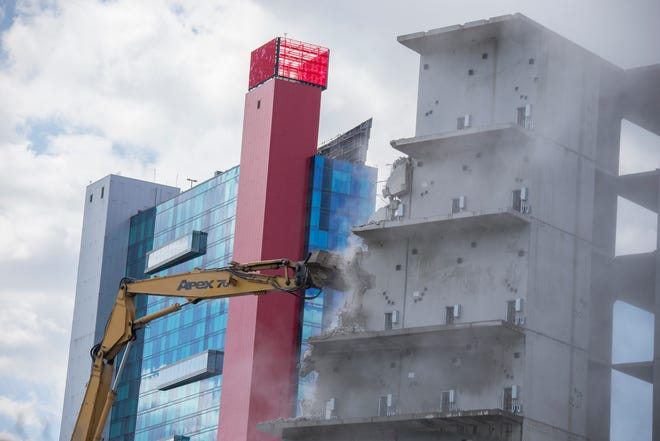 In this photo taken in July, 2018, demolition begins on a structure along Gratiot in downtown Detroit, which was to be the site of the county's new jail.